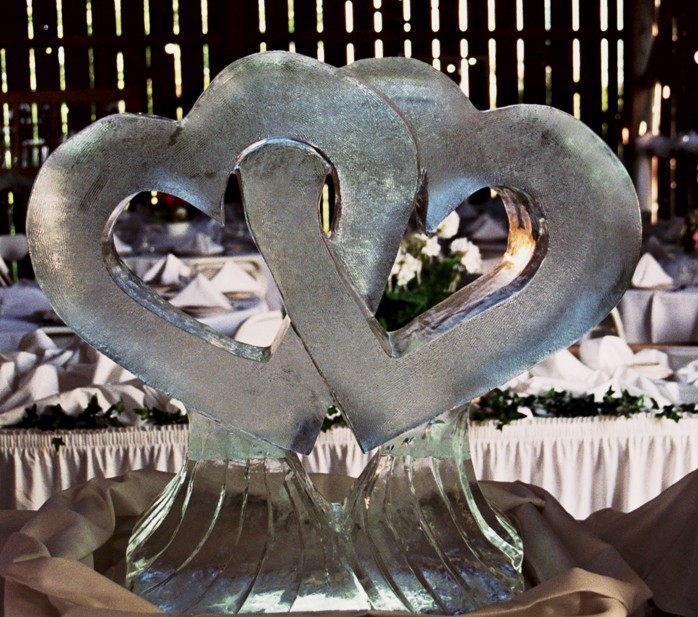 wedding ice sculptures, intertwined hearts ice sculptures, ice sculptures, ice sculpture, michigan ice sculptures, heart ice sculpture, Ice Impressions, Ice Impressions Ice Sculptures, Ice Sculptures, Ice Carvings, Ice Carving, Ice Sculpture, Wedding D&eacute;cor, Wedding Centerpieces, Wedding Flowers, Luxury Weddings, Wedding Ice Sculptures, Ice Sculptures Weddings, Ice Carving Wedding, Chicago Weddings, Ice Carvings for Weddings, Wedding Ice Bar, Ice Bars for Weddings, Northern Michigan Weddings, Winery Weddings, Barn Weddings, Vineyard Weddings, Traverse City Weddings, Wine Country Weddings, Glen Arbor Weddings, Weddings Glen Arbor.
