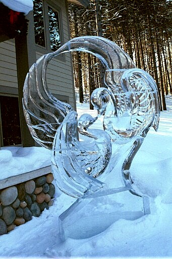 ice sculpture of two elegant ice swans