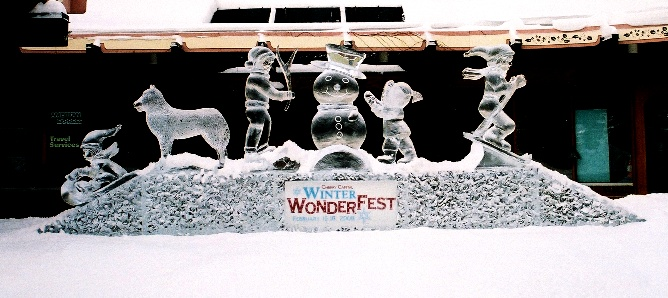 Ice Impressions, Michigan Winter Festival Ice Sculptures, Snowman Ice Sculpture, Skier Ice Sculpture, Dog Ice Sculpture, Ice Impressions.