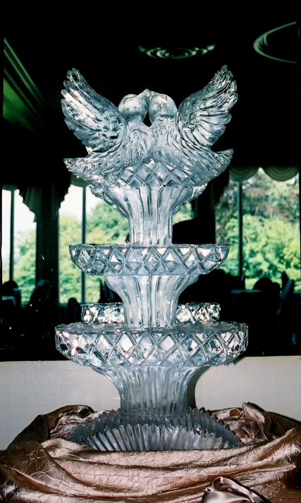love birds ice sculpture, ice sculptures, ice sculptures, ice sculpture, ice sculptures for weddings, michigan ice sculptures, michigan ice sculpture,  ice impressions, wedding ice sculptures, wedding ice sculpture, northern michigan wedding ice sculptures, special event ice sculptures, wedding decor ice sculptures, luxury wedding ice sculptures, Detroit Michigan ice sculptures.